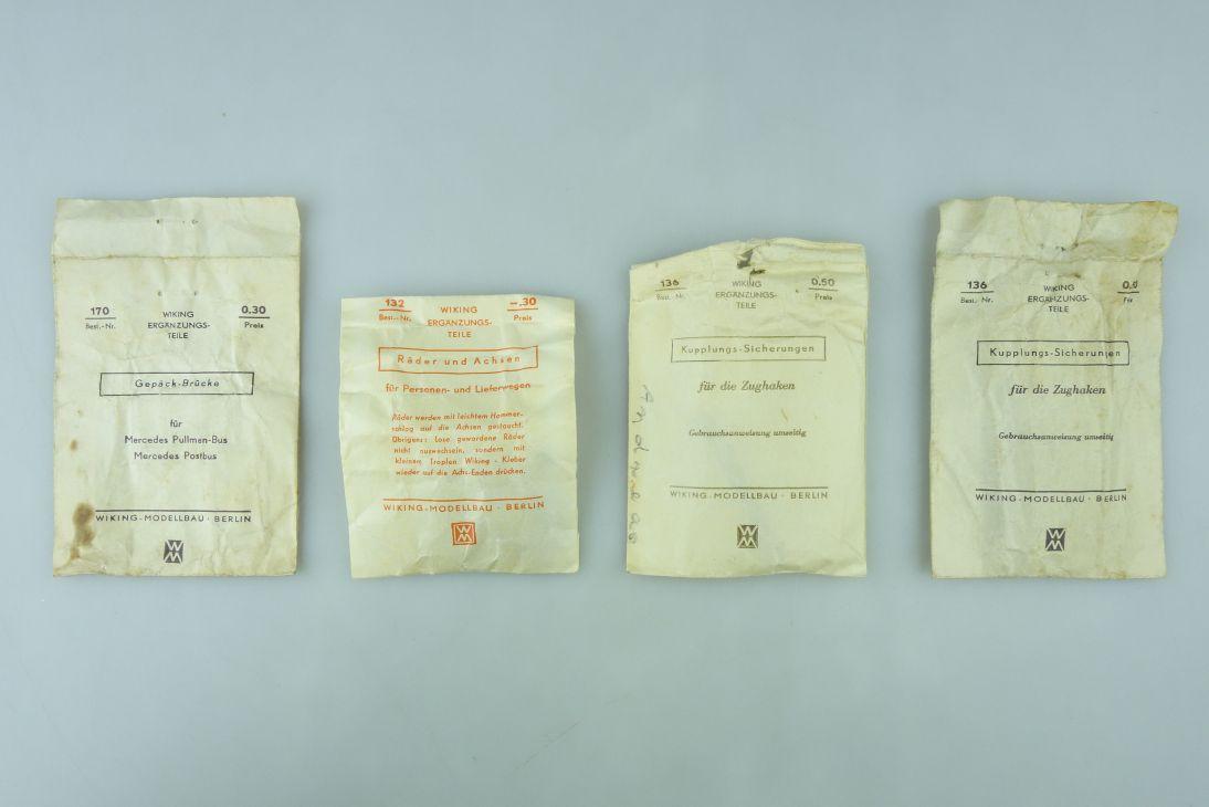 4x Wiking H0 Papiertüte 132 Räder Achsen 136 Kupplungs Sicherungen 170 107751