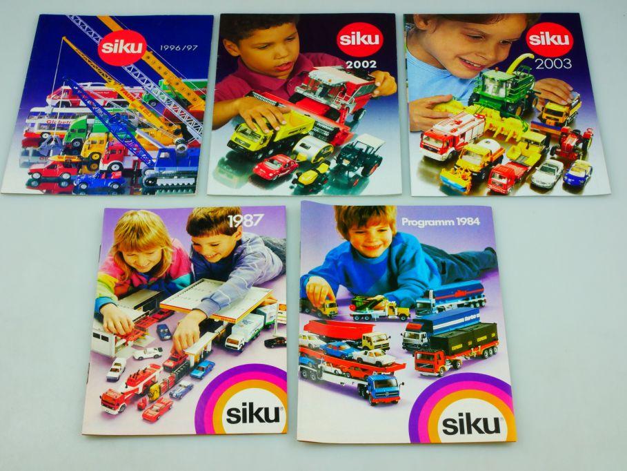 5x Siku Katalog 1984 1987 1996/97 2002 2003 diecast toy catalog 110354