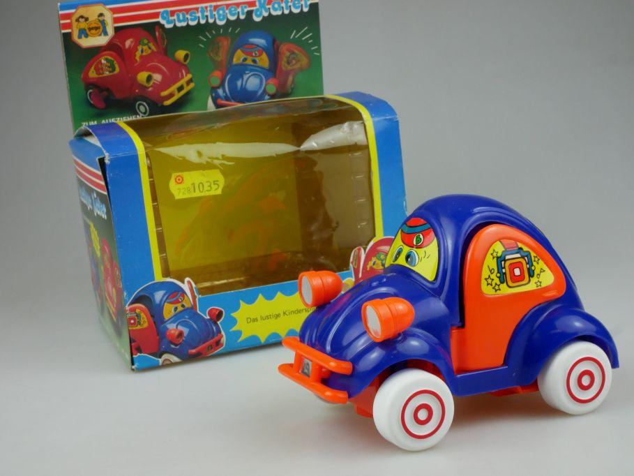80s toy Volkswagen VW beetle Lustiger Käfer Aufziehen flatter Türen Gegu 110531