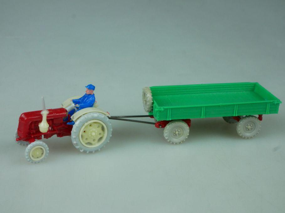 Haufe H0 Famulus RS 32 Feuerrot mit landwirtschaftlichem Anhänger DDR 113692